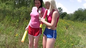 Two stunning girls are eating each others pussies in the acreage in broad daylight